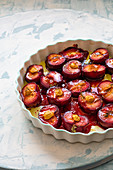 Roasted plums with olive oil, thyme and honey
