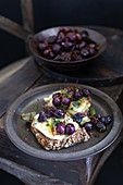 Whole wheat toast with stilton and roasted grapes