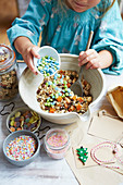 Kid mixing 'reindeer food' with seeds, oats and sweets