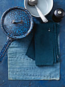 Blue saucepan, bowl, cutlery and cloth napkins