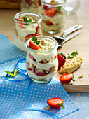 Layered desserts in glasses with strawberries and orange mascarpone