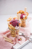 Vegan bubble waffles with blackcurrant sorbet, soya cream and colourful decorations
