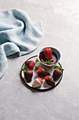 Dipping strawberries in melted chocolate