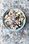 Celeriac ribbon 'pasta' tossed with chard, garlic and pumpkin seeds
