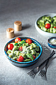 Vegeterian spinach and parmesan gnocchi with vine tomatoes