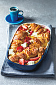 Strawberry and white chocolate croissant pudding