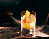 A Whiskey Sour against a dark surface