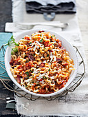 Long fusilli with dried mushrooms, tomatoes and sausage (Italy)