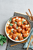 Oven-roasted meatballs in sauce