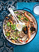 Buckwheat tagliatelle with seafood and courgettes