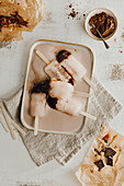 Homemade chocolate and caramel ice cream sticks