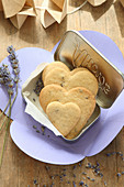 Heart-shaped, gluten-free lavender shortbread biscuits in a biscuit tin