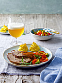 Beer-soaked roast beef with parmesan potatoes and vegetables