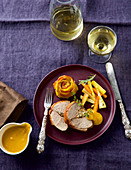 Stuffed goose breast with root vegetables and potato roses