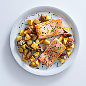 Roasted salmon with porcini mushrooms and fried potatoes
