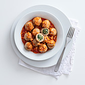 Potato and buckwheat gnocchi filled with spinach and walnuts with tomato sauce