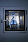 Using biohazard protective clothing and laboratory airlock
