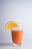 Freshly squeezed orange juice and orange slices