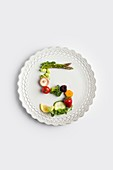 Plate with number 5 made of fruit and greens