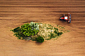 Farmer and tractor with seeder,aerial view