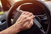 Driver pushing car horn