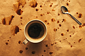 Coffee cup and spoon with splashes