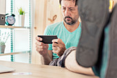 Freelancer playing game on smartphone