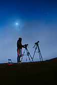 Astrophotographer and night sky