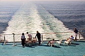 Passengers on the stern of a cross channel ferry