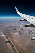 Cumulus humilis clouds and aircraft wing