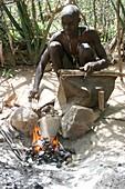 Datoga blacksmith lighting a fire