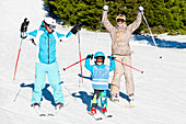 Happy family skiing