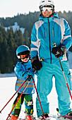 Boy having skiing lesson