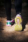 Close-up of walking shoes on a sandy path