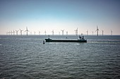 Ship passing wind turbines