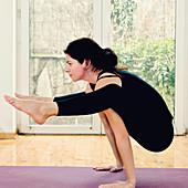 Yoga firefly position