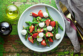 Green asparagus salad with strawberries and bocconcini
