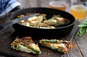Asparagus fritatta with parmesan cheese and feta