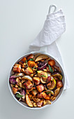 Warm vegetable salad with bacon croutons