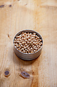 Dried chickpeas in a metal tin