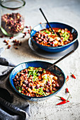Smoky chilli con carne with crispy bambara groundnuts