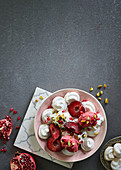 Vegan meringues with berry sorbet and plums