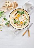 Smoked paprika and cumin-marinated eggs on yoghurt