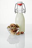 Pistachio nuts and a pistachio drink