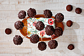 Chocolate cake pops with chocolate sprinkles