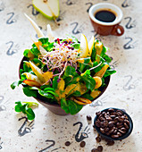 Lamb's lettuce with coffee vinaigrette and pears