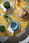 Retro yellow tablecloth on set table