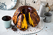 Marble pumpkin cake with chocolate icing