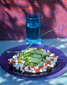 Feta with tomato and cucumber salad