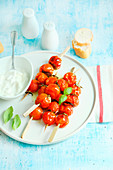 Roasted cherry tomato skewers served with fresh stracciatella